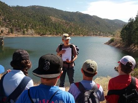 Eileen teaching students near Santa Fe. Photo courtesy of Santa Fe Watershed Association.